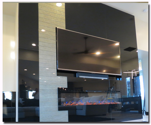 Custom wall feature with space for television and glass furnace in Black High Gloss Acrylic Luxe Panels