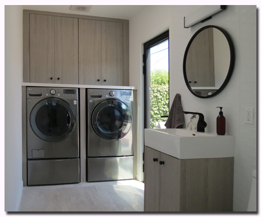 Custom RTA laundry cabinets and vanity featuring Cleaf Bagnola
